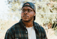 Eric Biddines Climbs Mountains In This Video. Does This MC's Single Pique Your Interest?